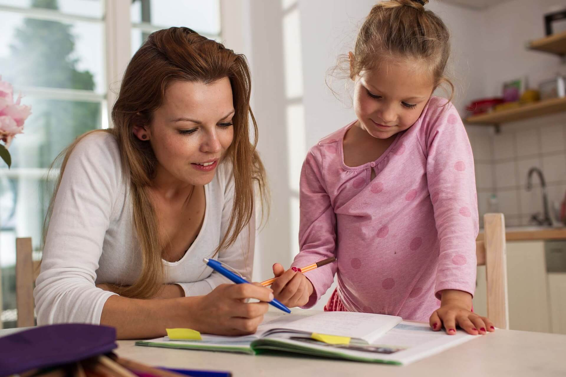 children leaning with parents help